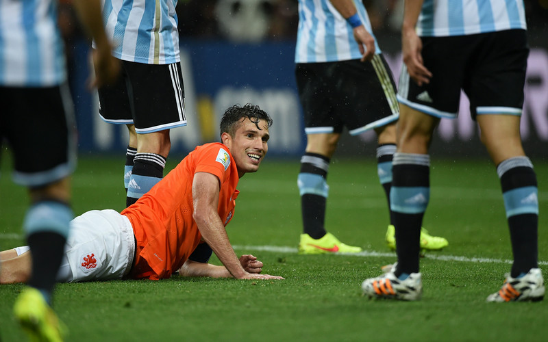 . Netherlands\' forward and captain Robin van Persie (C) reacts after a miss on goal during the semi-final football match between Netherlands and Argentina of the FIFA World Cup at The Corinthians Arena in Sao Paulo on July 9, 2014. (PEDRO UGARTE/AFP/Getty Images)