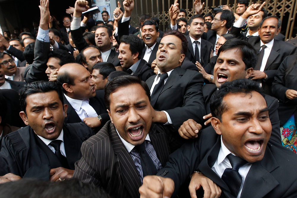 . Lawyers loyal to the Bangladesh Nationalist Party shout slogans as they protest in the premises of the Dhaka Judge Court during a strike in Dhaka on December 11, 2012. At least 134 were detained during a countrywide general strike on Tuesday as activists of the Bangladesh Nationalist Party-led 18-party alliance clashed with police and vandalized vehicles. The 18-party alliance enforced the shutdown protesting against government obstruction during their countrywide road blockade program on Sunday, local media reported. REUTERS/Andrew Biraj