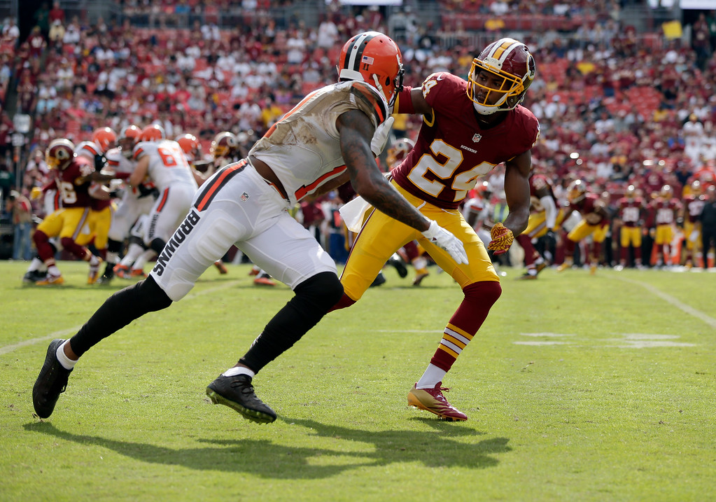 . Cleveland Browns wide receiver Terrelle Pryor (11) is defended by Washington Redskins cornerback Josh Norman (24) during the second half of an NFL football game Sunday, Oct. 2, 2016, in Landover, Md. (AP Photo/Mark Tenally)