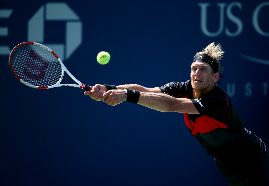 . NEW YORK, NY - AUGUST 26:  Jarkko Nieminen of Finland returns a shot against Ivo Karlovic of Croatia during their men\'s singles first round match on Day Two of the 2014 US Open at the USTA Billie Jean King National Tennis Center on August 26, 2014  in the Flushing neighborhood of the Queens borough of New York City.  (Photo by Streeter Lecka/Getty Images)