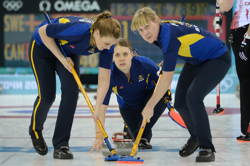 . Sweden\'s Agnes Knochenhauer (C) watches the stone during the Women\'s Curling Gold Medal Game Sweden vs Canada at the Ice Cube Curling Center during the Sochi Winter Olympics on February 20, 2014. JUNG YEON-JE/AFP/Getty Images