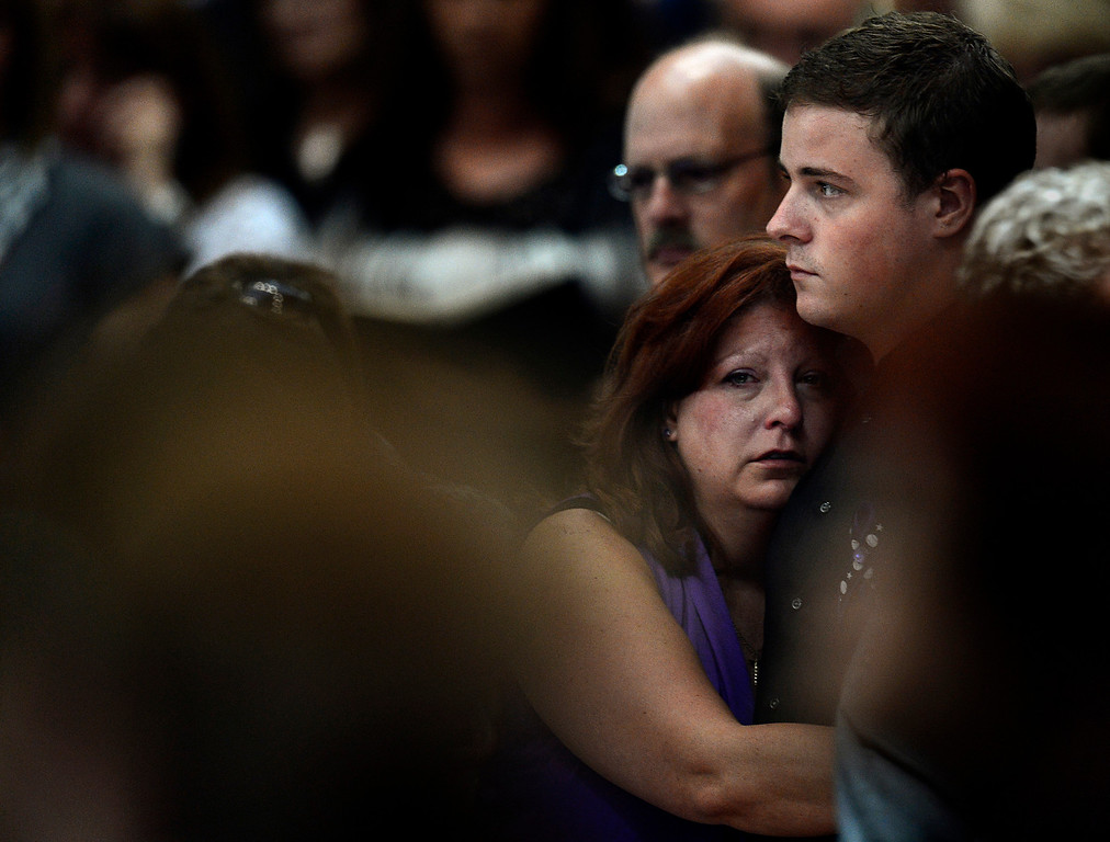 . Theresa Hoover holds her son, Wil Boik, 22, during the funeral of her younger son, AJ Boik, on Friday, July 27, 2012 at the Queen of Peace Catholic Church in Aurora. AJ Boik was killed in the Aurora Theater shooting. Joe Amon, The Denver Post