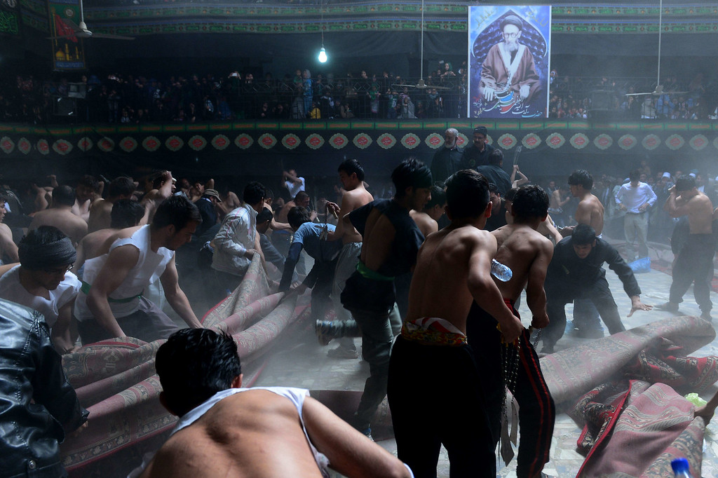 . In this photograph taken on October 31, 2014 Afghan Shiite Muslim devotees prepare to beat themselves with chains and blades as part of a self-flagellation ritual during Ashura commemorations at a mosque in Kabul on October 31, 2014. WAKIL KOHSAR/AFP/Getty Images