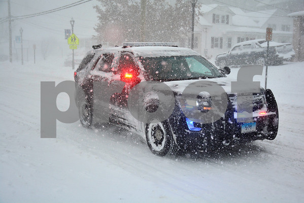 1/4/2018 Mike Orazzi | Staff A Plymouth police cruiser on Route 6 during Thursday's snow storm in Terryville.
