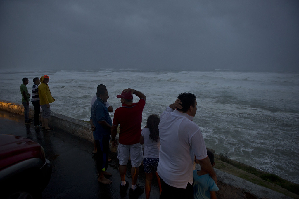 . People watch waves in Cabo San Lucas, Baja California State, Mexico, on September 14, 2014. Hurricane Odile swirled menacingly toward Mexico\'s Los Cabos resorts on Sunday, forcing authorities to evacuate high-risk areas and open shelters as the powerful storm threatened to thrash the Pacific coast. AFP PHOTO/RONALDO SCHEMIDT/AFP/Getty Images