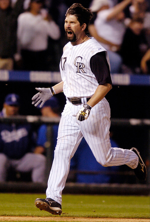 . Todd Helton celebrated his game-winning homerun as he rounded third base.  He hit the ninth-inning dinger off Dodger reliever Takashi Saito.     Karl Gehring/The Denver Post