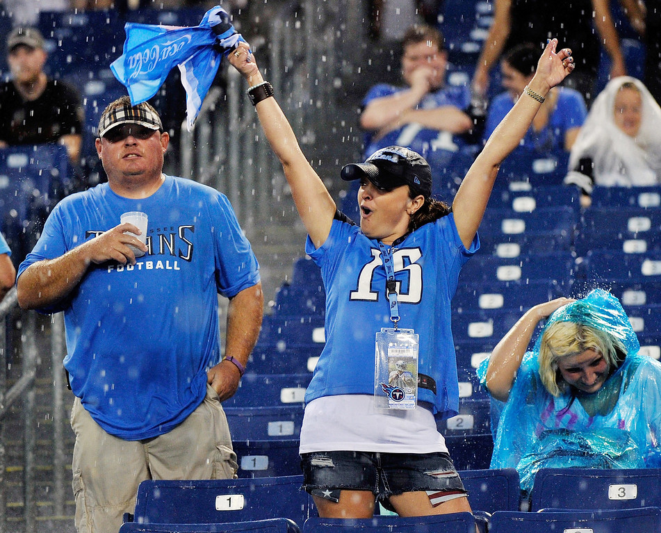 . A fan of the Tennessee Titans cheers in the rain. (Photo by Frederick Breedon/Getty Images)