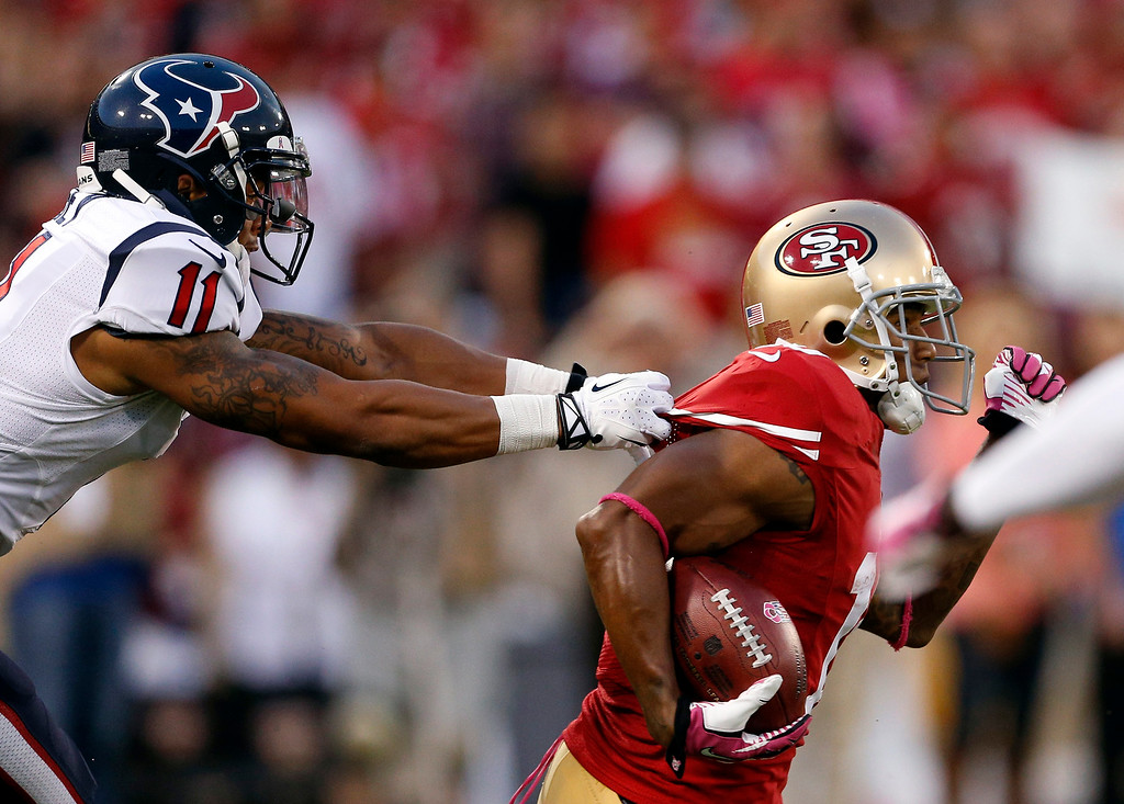 . San Francisco 49ers wide receiver Kyle Williams, right, carries the ball as Houston Texans wide receiver DeVier Posey pulls his jersey in the first half of an NFL football game in San Francisco, Sunday, Oct. 6, 2013.  (AP Photo/Beck Diefenbach)