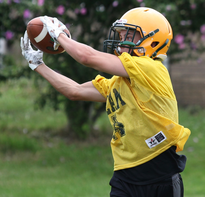 . Randy Meyers - The Morning Journal<br> An Amherst receiver eyes the catch during Amherst\'s first football practice on July 30.