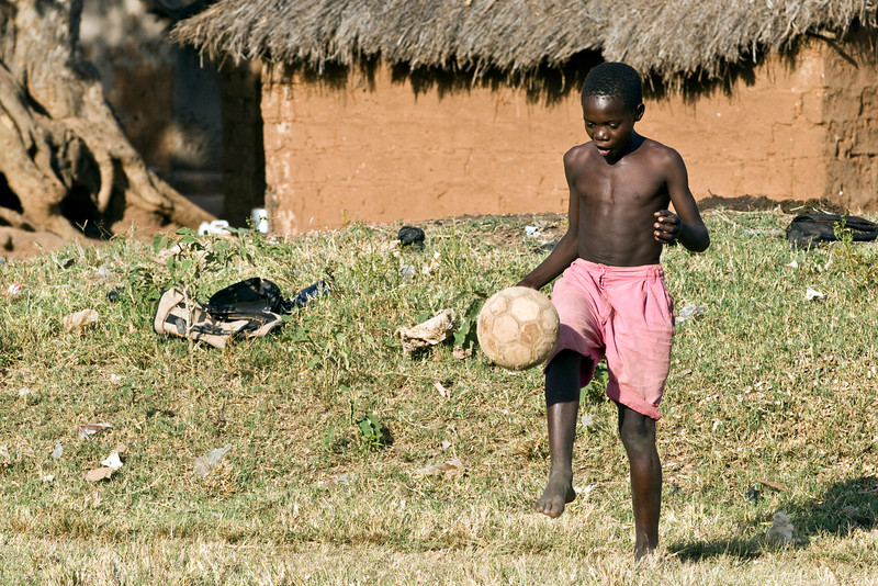kid playing football during a right to play activity