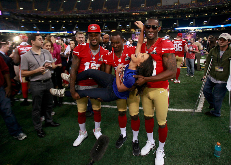 . Television personality Rocsi Diaz gets a lift from San Francisco 49ers players, including wide receiver A.J. Jenkins (L) and free safety Trenton Robinson (C), during Media Day for the NFL\'s Super Bowl XLVII in New Orleans, Louisiana January 29, 2013. The 49ers will meet the Baltimore Ravens in the game on February 3.  REUTERS/Sean Gardner