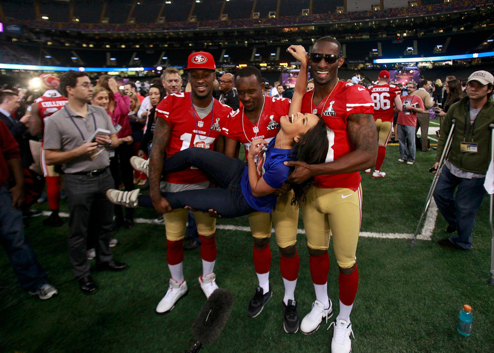 Description of . Television personality Rocsi Diaz gets a lift from San Francisco 49ers players, including wide receiver A.J. Jenkins (L) and free safety Trenton Robinson (C), during Media Day for the NFL's Super Bowl XLVII in New Orleans, Louisiana January 29, 2013. The 49ers will meet the Baltimore Ravens in the game on February 3.  REUTERS/Sean Gardner