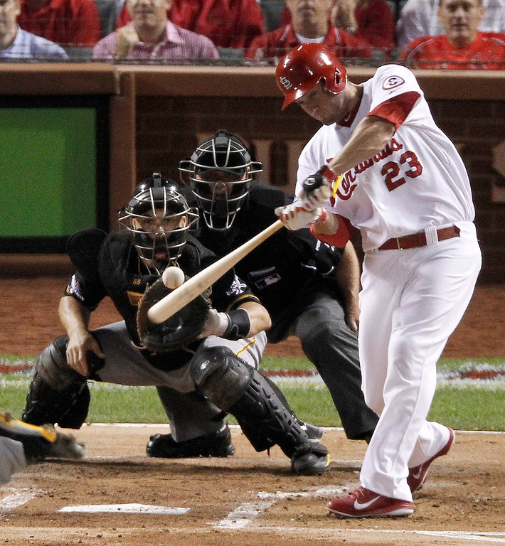 . St. Louis Cardinals\' David Freese (23) hits a two-run home run against the Pittsburgh Pirates in the second inning of Game 5 of a National League baseball division series, Wednesday, Oct. 9, 2013, in St. Louis. Catching for the Pirates is Russell Martin. (AP Photo/Sarah Conard)