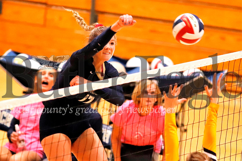 Knoch's Kennedy Christy (#17) goes for a spike during the Knights' 3-0 home win Tuesday over Mars. Seb Foltz/Butler Eagle