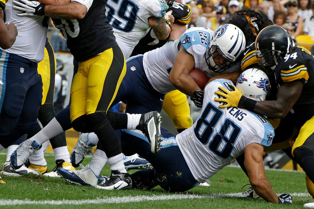 . Tennessee Titans running back Jackie Battle (22) pushes across the goal line for a second-quarter touchdown with Titans tight end Craig Stevens (88) blocking Pittsburgh Steelers linebacker Lawrence Timmons (94) during an NFL football game in Pittsburgh, Sunday, Sept. 8, 2013. (AP Photo/Gene J. Puskar)
