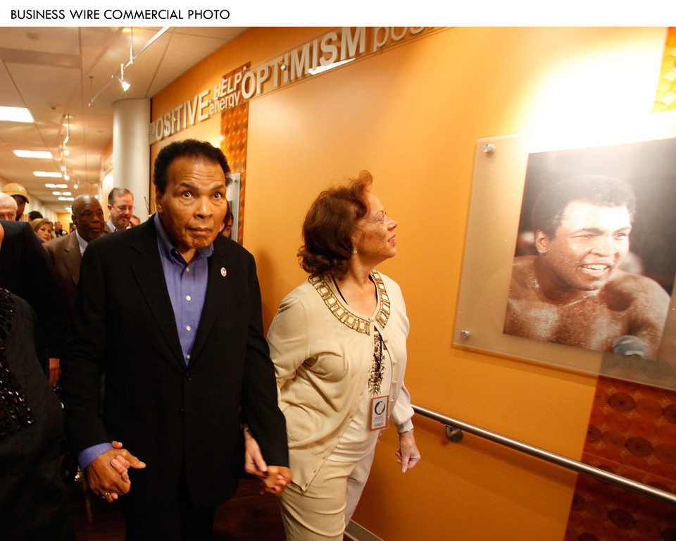 . Muhammad and Lonnie Ali tour the new $4 million Muhammad Ali Parkinson Center in the Barrow Neurological Institute at St. Joseph\'s Hospital in Phoenix. The Alis participated in the grand opening today of the center, which has been decorated with images from throughout Muhammad\'s boxing career. The Muhammad Ali Parkinson Center at Barrow will provide care and treatment to thousands of Parkinson patients from throughout the United States. The 10,000-square-foot facility is the most comprehensive Parkinson\'s center in the nation. 2009 (Photo: Business Wire)