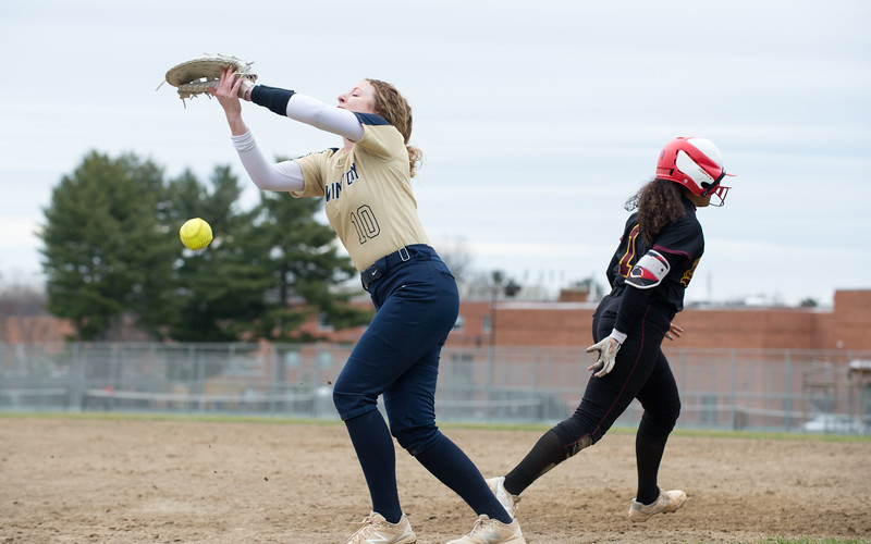 04/11/19  Wesley Bunnell | Staff  New Britain softball defeated Newington on the road 4-1 on Thursday afternoon. Joseleen Rivera (1) collides with Newington's Rachel Thureson (12) causing her to drop the ball but Rivera would be called out for interference.