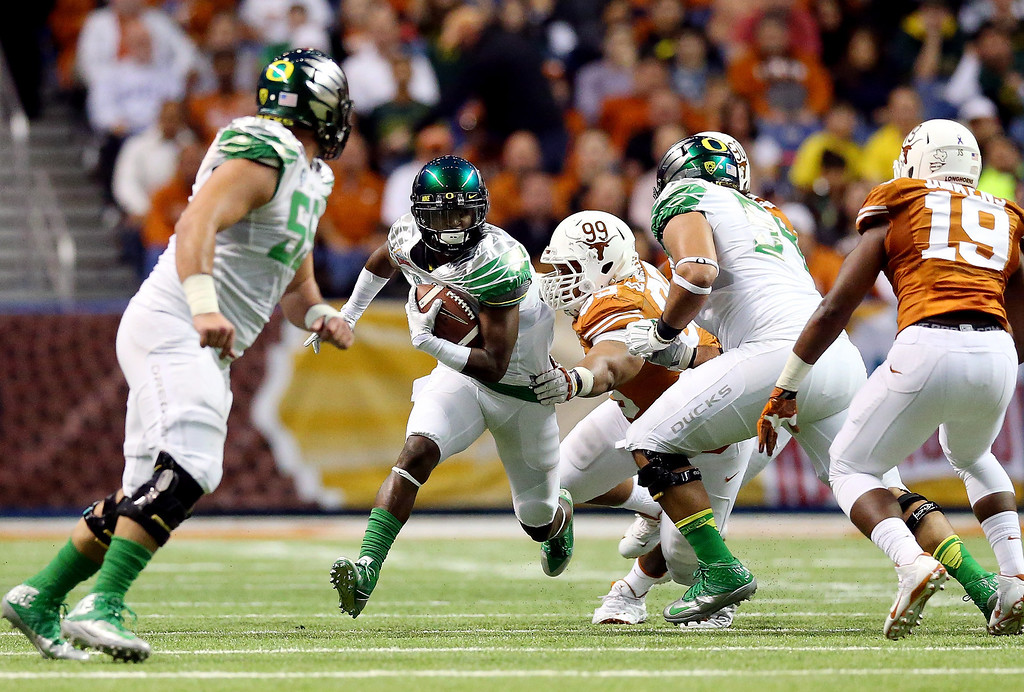 . Wide receiver Bralon Addison #11 of the Oregon Ducks runs after a catch against the Texas Longhorns during the Valero Alamo Bowl at the Alamodome on December 30, 2013 in San Antonio, Texas.  (Photo by Ronald Martinez/Getty Images)