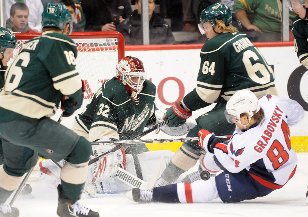. Minnesota Wild goalie Niklas Backstrom deflects a puck from Washington Capitals  Mikhail Grabovski during the first period.  (Pioneer Press: Sherri LaRose-Chiglo)
