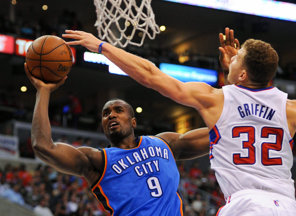 . The Thunder\'s Serge Ibaka goes to the hoop against Blake Griffin. (Photo by Michael Owen Baker/Los Angeles Daily News)
