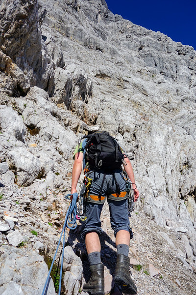 """Time to go! After a long and lazy morning to let the rock dry, we continue along the last short part of Gipfelschlucht. After that only the """"Ausstiegskamine"""" (exit chimney system) lies between us and the summit ridge."""