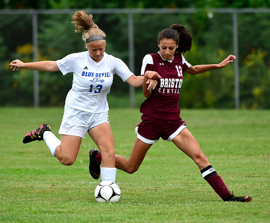 9/7/2018 Mike Orazzi | Staff Plainville's Sarah Tomczyk (13) and Bristol Central's Adalia Malick (12) during Friday's soccer at BC.