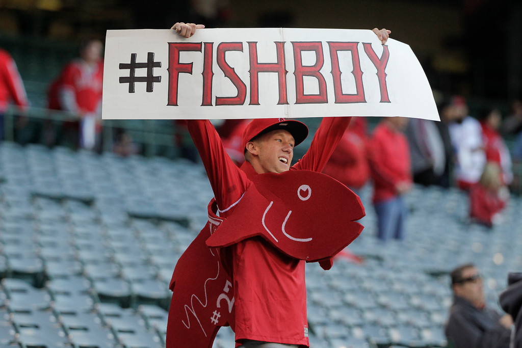 . A fan holds up a sign for Los Angeles Angels\' Mike Trout before an opening day baseball game between the Los Angeles Angels and the Seattle Mariners on Monday, March 31, 2014, in Anaheim, Calif. (AP Photo/Jae C. Hong)