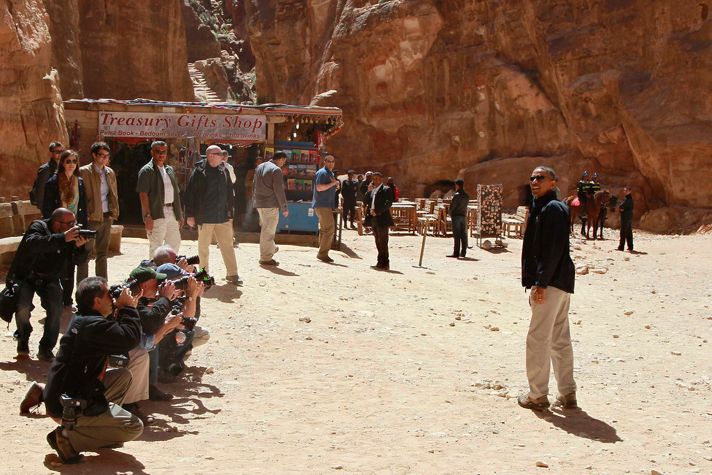 . U.S. President Barack Obama (R) poses at the Treasury as he takes a walking tour of the ancient historic and archaeological site of Petra March 23, 2013. Obama visited Jordan\'s ancient city of Petra on Saturday as he wrapped up a four-day Middle East tour by setting aside weighty diplomatic matters and playing tourist for a day. REUTERS/Muhammad Hamed