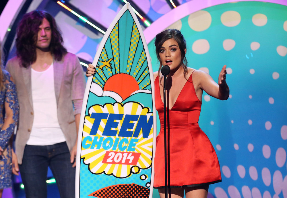 . Lucy Hale accepts the award for choice TV actress for ìPretty Little Liarsî at the Teen Choice Awards at the Shrine Auditorium on Sunday, Aug. 10, 2014, in Los Angeles. Looking on at left is Reid Perry. (Photo by Matt Sayles/Invision/AP)