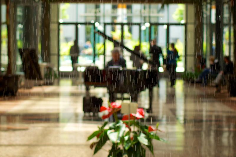 Indoor rain? Photo of a Pianist shot through the Rincon Center Rain Column. ref: 83a35efd-4658-4ca9-96c9-4ca791b1b613