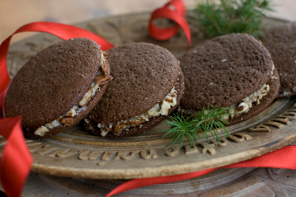 ". A purely American invention, German chocolate cake starts with a sweet chocolate cake, then is filled with a caramel-coconut-pecan concoction. <a href=""https://www.yahoo.com/news/german-chocolate-cake-reimagined-cookie-154229907.html\"">Get the recipe for German chocolate sandwich cookies</a>.  (AP Photo/Matthew Mead)"