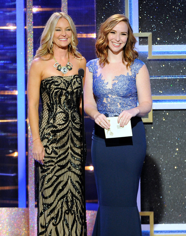 . Sharon Case, left, and Camryn Grimes present the award for outstanding drama series writing team at the 41st annual Daytime Emmy Awards at the Beverly Hilton Hotel on Sunday, June 22, 2014, in Beverly Hills, Calif. (Photo by Chris Pizzello/Invision/AP)