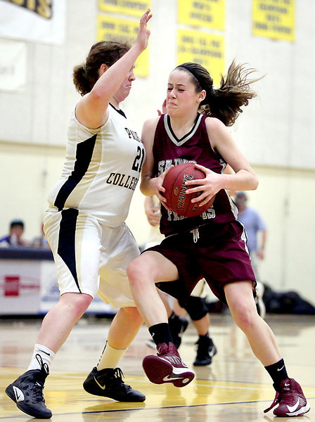 . St. Francis Senior Lauren Price collides with PCS Junior Margi Howard as she speeds towards the net on Friday night at Notre Dame de Namur University in Belmont during the CCS Division V Championship game. (Kevin Johnson/Sentinel)