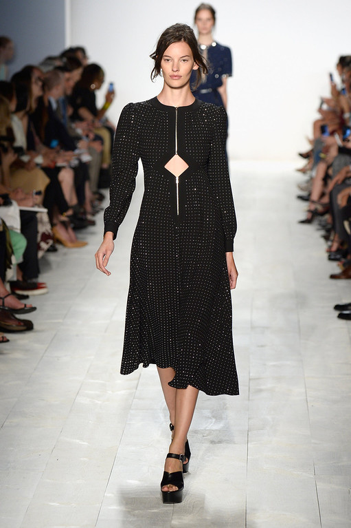 . A model walks the runway at the Michael Kors fashion show during Mercedes-Benz Fashion Week Spring 2014 at The Theatre at Lincoln Center on September 11, 2013 in New York City.  (Photo by Frazer Harrison/Getty Images for Michael Kors)