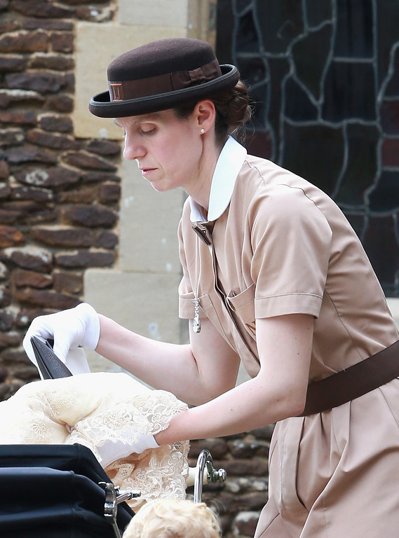 . Prince George\'s nanny, Maria Teresa Turrion Borrallo (in her Norland Nanny Uniform) helps secure Princess Charlotte of Cambridge in her pram as she leaves the Church of St Mary Magdalene on the Sandringham Estate for the Christening of Princess Charlotte of Cambridge on July 5, 2015 in King\'s Lynn, England.  (Photo by Chris Jackson/Getty Images)