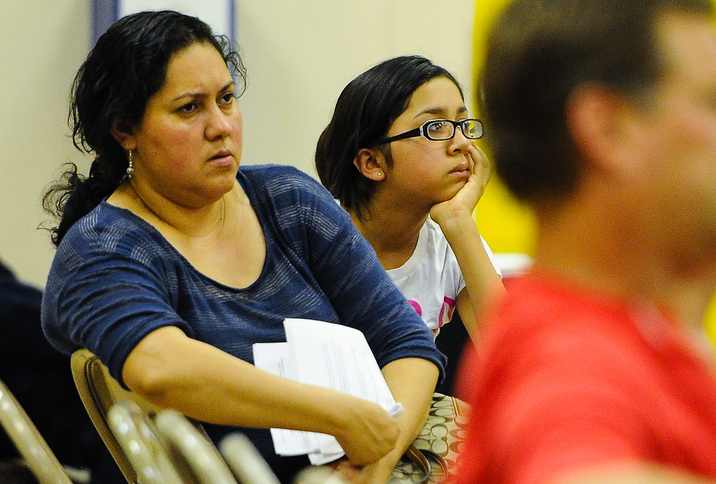 . Hinkley residents listen to the latest updates about the chromium-6 groundwater plume, and PG&E\'s remediation strategies during a Community Advisory Committee meeting in the Hinkley School auditorium in Hinkley, Calif. on Thursday, June 27, 2013. (Rachel Luna / San Bernardino Sun)