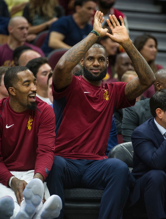. Cleveland Cavaliers\' LeBron James, right gets a laugh out of JR Smith during the second half of an NBA preseason basketball game against the Atlanta Hawks in Cleveland, Wednesday, Oct. 4, 2017. James did not play in the Cavaliers 109-93 loss to the Hawks. (AP Photo/Phil Long)