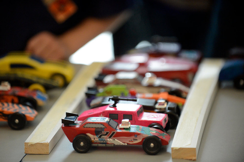 . COMMERCE CITY, CO. - JANUARY 26: Contestants pinewood cars ready in the pit for the the start of the 2013 Pack 414 Pinewood Derby races at Ortho Stuart Middle School January 26, 2013 in Commerce City. The pinewood cars weigh 5 oz and are 7 inches long. The scouts can either buy a kit with the car already shaped or buy a block of wood and carve their own.  (Photo By John Leyba / The Denver Post)
