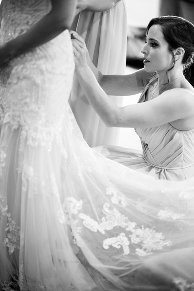 Andrea getting her gown on in the bridal suite at Wyndridge Farm (with bridesmaids help) -  Designer/Planner – Shayla Button (Day-of coordinator for Wyndridge Farm) // Bridal Shops: Bridals by Elena