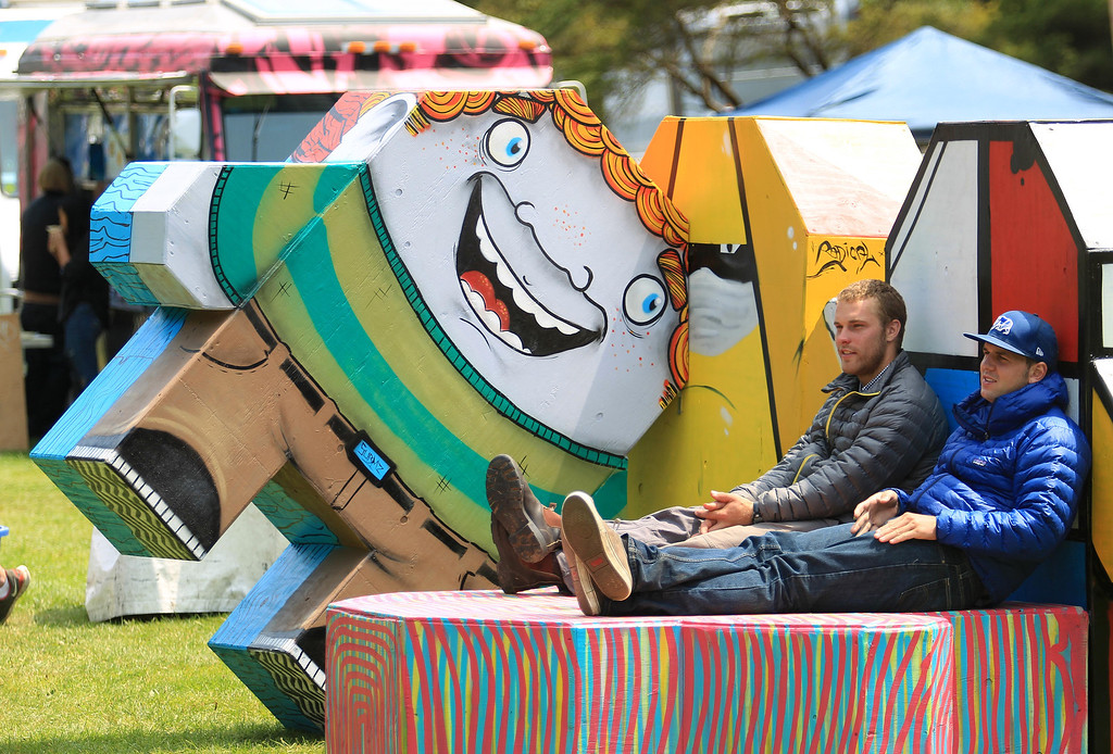 . Peter Siegenthaler, left, and Arran Caddy, of San Francisco, hang out on a sculpture during the 6th annual Outside Lands Music and Arts Festival in Golden Gate Park in San Francisco, Calif., on Friday, Aug. 9, 2013.  (Jane Tyska/Bay Area News Group)