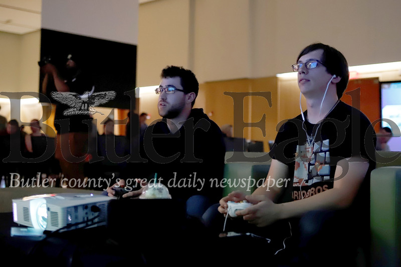Joshua Malone (right) and Francisco Maya compete in Friday's E Sports competition at Slippery Rock University. Seb Foltz/Butler Eagle 10/19/19