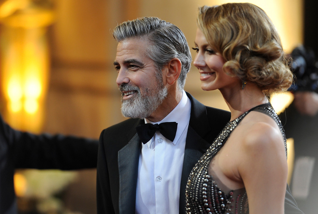 . Actors George Clooney and Stacy Keibler arrives at the 85th Academy Awards at the Dolby Theatre in Los Angeles, California on Sunday Feb. 24, 2013 ( Hans Gutknecht, staff photographer)