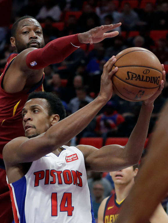 . Cleveland Cavaliers guard Dwyane Wade, top, reaches as Detroit Pistons guard Ish Smith (14) tries to pass during the first half of an NBA basketball game, Monday, Nov. 20, 2017, in Detroit. (AP Photo/Carlos Osorio)