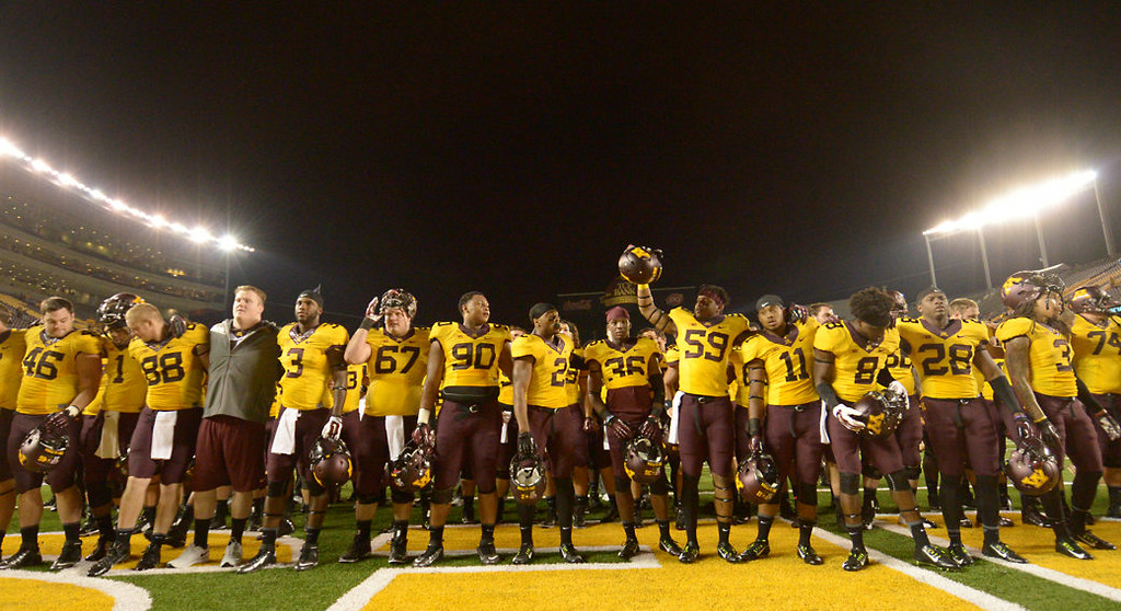 . The Minnesota Gophers  line up to sing the rouser after beating Eastern Illinois 42-20.  (Pioneer Press: John Autey)