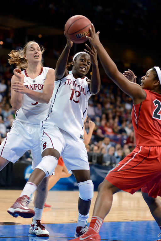. Georgia\'s Shacobia Barbee goes for a rebound against Stanford\'s Chiney Ogwumike while Stanford\'s Mikaela Ruef, left, watches in the first half of a regional semifinal in the NCAA women\'s college basketball tournament, Saturday, March 30, 2013, in Spokane, Wash. (AP Photo/Jed Conklin)