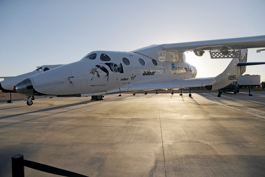 . n this Sept. 25, 2013, file photo, shows Virgin Galactic\'s SpaceShipTwo at a Virgin Galactic hangar at Mojave Air and Space Port in Mojave, Calif. (AP Photo/Reed Saxon, File)