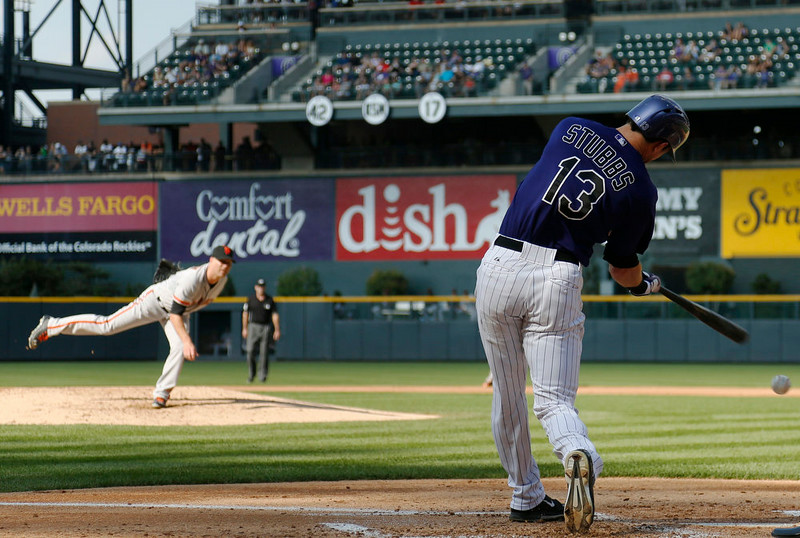 . Colorado Rockies\' Drew Stubbs (13) strikes out swinging at pitch delivered by San Francisco Giants starting pitcher Tim Hudson in the first inning of a baseball game in Denver on Monday, Sept. 1, 2014. (AP Photo/David Zalubowski)