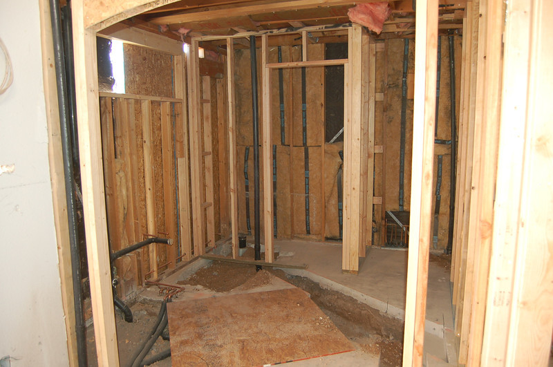 Master bath; almost no concrete floor left with all the cuts. The center of the picture shows the future toilet room, shower to its right and vanity to its left (window above the future vanity).
