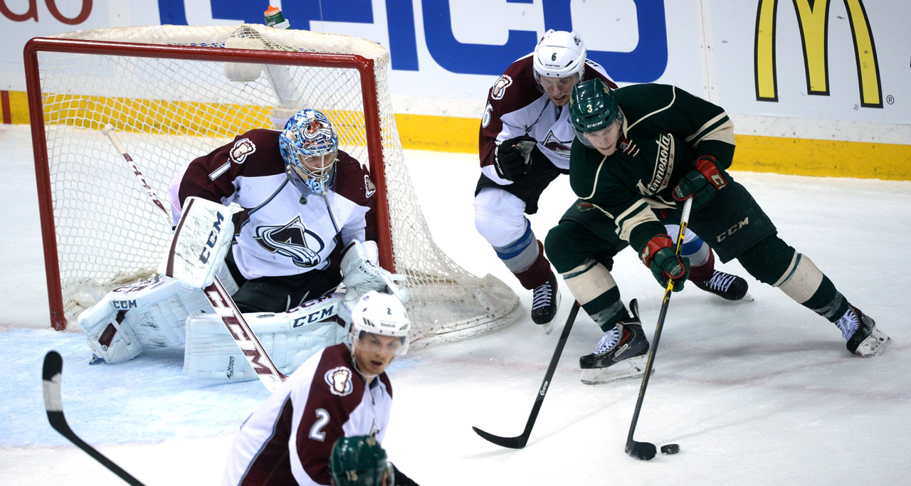 . Minnesota Wild\'s charlie Coyle get a shot on goal past Colorado Erik Johnson during the third period of Game 3 of the Stanley Cup Playoffs at Xcel Energy Center  in St. Paul on Monday, April 21, 2014. (Pioneer Press: Sherri LaRose-Chiglo)