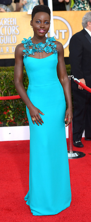 . Lupita Nyong\'o arrives at the 20th Annual Screen Actors Guild Awards  at the Shrine Auditorium in Los Angeles, California on Saturday January 18, 2014 (Photo by Michael Owen Baker / Los Angeles Daily News)